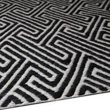 black and white geometric rug. black - patterned geometric rug. preloader. loading. and white rug n