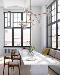 floating bubble chandelier with white dining table also decorative pillows for elegant dining room