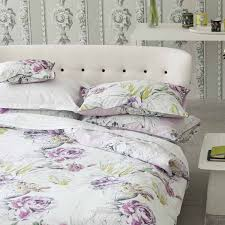 white bedding set with purple flowers