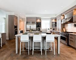 Elegant Brown Floor Kitchen Photo In Montreal With Stainless Steel  Appliances