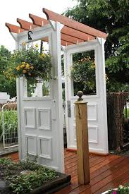 turn old doors into an arbor doors and windows in the garden a gallery of ideas
