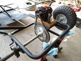motor installed on a temporary wood spacer as well as the chain was test fitted the wood spacer was later replaced by 2 aluminum beams