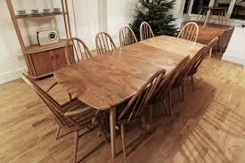the chairs are ercol windsor quakers 8 standard chairs and 2 carvers an elegant ercol grand windsor table plus 10 quaker chairs this