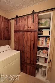 white sliding barn doors. Amazing Design Ideas To Build A Sliding Barn Door In Your House : Sweet Laundry Room White Doors