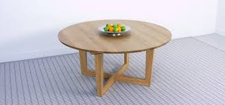 round dining table in solid oak and x shaped base brunel round