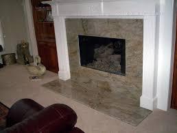 marble subway tile fireplace surround has white molding