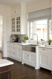 kitchen lighting over sink. Kitchen Light Shades Ideas Using Natural Grey Linen Fabric For Roman Window Blinds Above Single Lever Lighting Over Sink