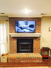 tv mounted on a brick fireplace in lexington cky platinum audio visual