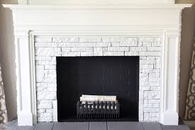 DIY Faux Fireplace Updated | blesserhouse.com - This fireplace looks so  real and it