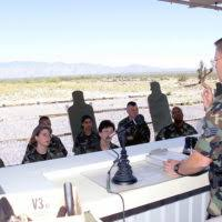 STAFF Sergeant (SSGT) Merle Hudson, Combat Arms instructor, 355th Security  Forces Squadron, Davis-Monthan (D-M) Air Force, Base Arizona, gives final  instructions on safety and firing point procedures to D-M personnel during  qualification
