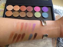 makeup case professional eyeshadow palette swatches below 3 shades from left are from mufe artist palette the rest ofra cosmetics
