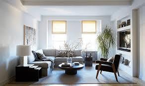 light grey linen fiber sectional sofa platinum area rug round walnut wood coffee table black nesting table dark brown bonded leather arm chair