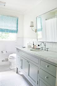 family bath inspiration painted vanity sconces wall tile roman shade