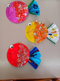 these adorable tropical fish start with painted paper plates and pieces of aluminum foil each fish is one of a kind