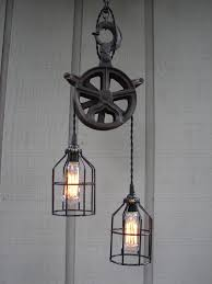 pulley lighting. Upcycled Vintage Industrial Pulley Lighting Pendant With Bulb Cages. $276.00, Via Etsy. -
