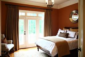earth tone home decor bedroom traditional with wood flooring white
