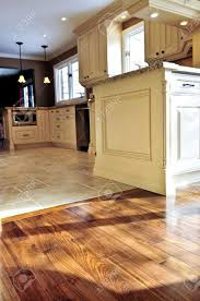 Wood Tile Floor Kitchen Hardwood And Tile Floor In Residential Home Kitchen And Dining