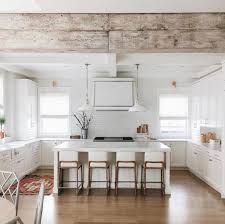 Rustic beam in white modern farmhouse kitchen | k i t c h e n in ...