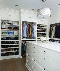white wood shelves lighting fixture built walk closet wood floor drum pendant white cabinets shoe rack storage shoe storage master closet crown molding
