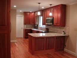 H Astonishing Mahogany Wood Kitchen Cabinets With White Marble Countertop And  Glass Tile Backsplash Interior Decor