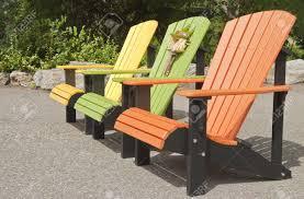 adirondack chairs plastic 8 7796402 colorful plastic adirondack chairs stock photo jpg