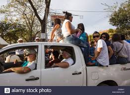 Teenagers riding back of pickup truck during a parade at Coco Beach ...