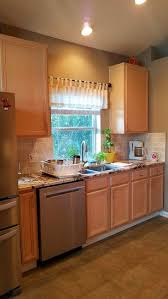 How To Decorate A Kitchen With Black Appliances White Vs Stainless ...