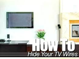 tv wires above fireplace hide
