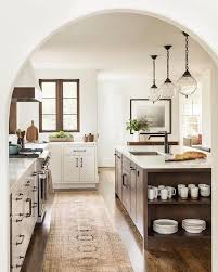 White kitchen with warm wood and glass globe pendants | cookin ...