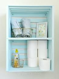 blue wooden crate storage create bathroom with crates hung on the wall as shelves floor units