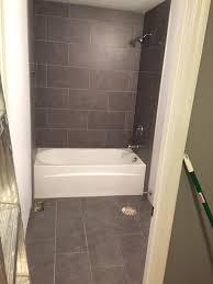 Lowes mitte gray tile 12x24 bathroom tub surround and floors bath