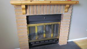 knockout gas fireplace design with white mantel surround astounding decorating ideas brick stone and solid pine wood