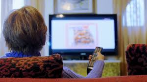 watching tv at home. old woman watching tv at home h