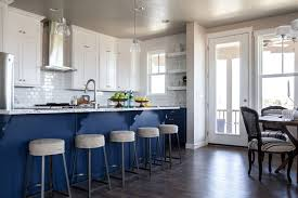 blue kitchen island with blue and grey granite countertops