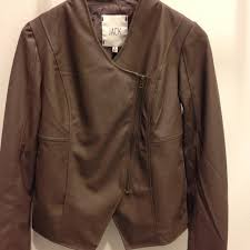 every closet needs a go to item that looks good with everything we ve found it in this taupe faux leather jacket by jack girls can stay warm on new year s