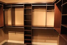 closet system bar brown wooden closet with wooden shelves and racks also steel rod on