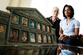 Ann and Byron Grant of Oakville, Ont., with photographs of their son Evan  Horkoff. Horkoff was killed in a workplace accident in Alberta in 2011. His  employer was charged in relation to