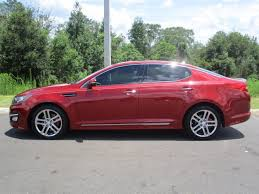 kia optima 2013 red. 2013 kia optima gasoline 4 door with alloy wheels red