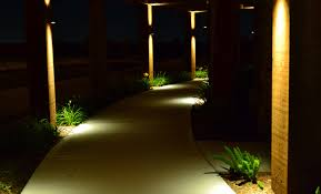 m m lighting houston tx. a sidewalk with pillars lamps shining light up and down the columns. m lighting houston tx l