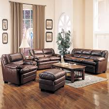 interior vintage living room set up with dark brown leather sofa and wooden coffee table