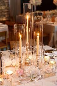 Alternating votive and taper candles wedding centerpiece /  http://www.deerpearlflowers.