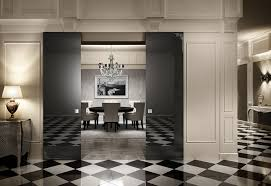 exterior interior hotels meeting room decoration with black glass sliding door on white painted wall panel