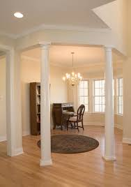 Luxury Living Room Decors With Tapered Round Plain Interior Columns Added  Rounded Living Room Rug Ideas As Well As Chandelier Glass Over Calssy  Living Sets ...