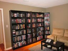 elegant big bookcase decorating ideas with cream leather sofa set also black stained wooden coffee table on grey carpet floor plus laminate wooden floor