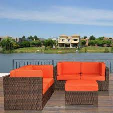 nice brown 5 piece patio sectional seating set with orange cushions