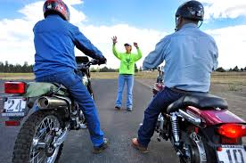 training instructor barb fincher works with a pair of students during a basic rider course wednesday