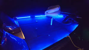 bass boat led light system at night on the water