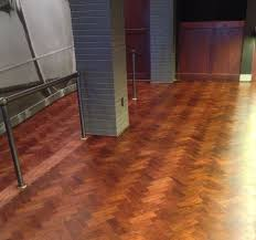 repaired and stained herringbone floor satin finish