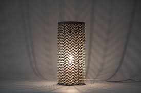 set of 2 modern taupe metal cut out arrows cylindrical table lamp bedside lights
