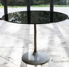 notting black glass top and brass column 80cm round dining table with cencrete base